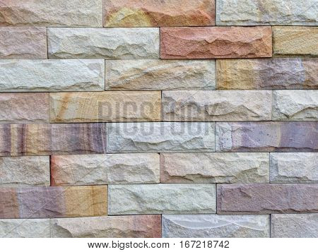 Sandstone brick wall pattern and background texture