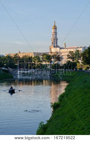 KHARKIV UKRAINE - JULY 06 2016: The bell tower of the Assumption Cathedral (Uspenskiy Sobor) philharmonic organ hall in Kharkiv Ukraine view from the river