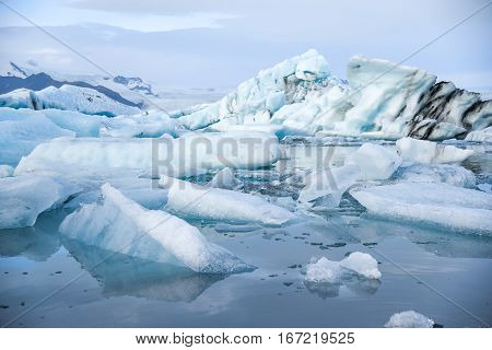 Iceberg in Jokulsarlon glacier lagoon originating from the Vatnajokull (the biggest glacier in Europe) beautiful nature landscape in winter season of Iceland