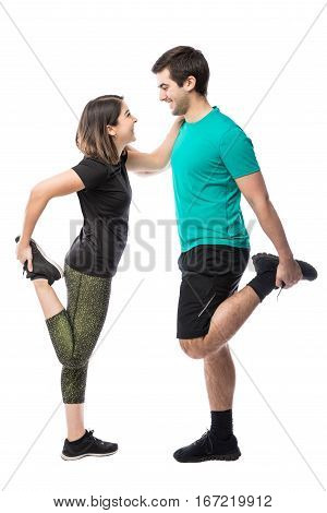 Young Couple Warming Up For Exercise
