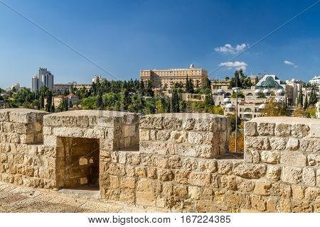 View of Jerusalem neighborhood Yemin Moshe from the wall of the Old City in Jerusalem Israel