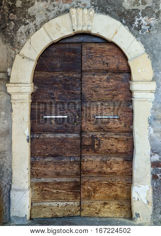 Vintage wooden entrance door with forged ironwork