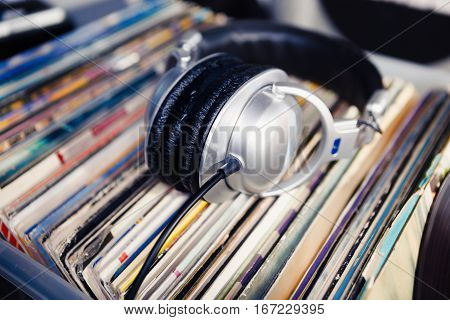 Dj Headphones Laying On Vinyl Records With Music