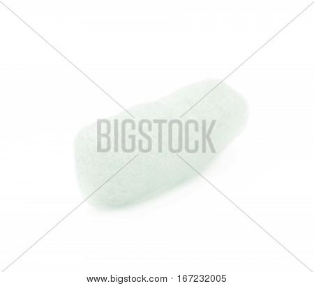 Single bioplastic packing foam peanut isolated over the white background