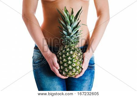Female stomach and hands holding ananas. IVF, pregnancy concept.