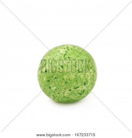 Single green colored foam ball or a corn cereal candy isolated over the white background