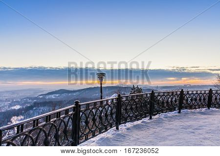 Winter landscape during sunset in the Lviv city