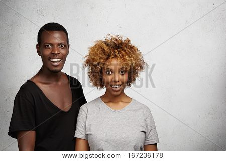 Astonished Young African Man And Woman Dressed Casually Having Stunned And Surprised Expression On T