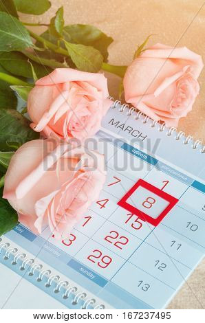 8 March card - peach roses over the calendar with framed 8 March date. 8 March festive postcard