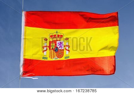 Spain flag waving on the sky. National symbol of spanish people