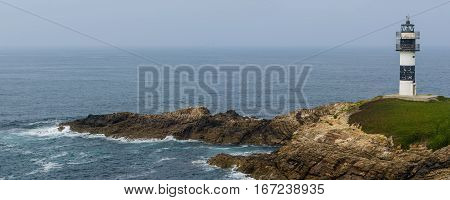 Panoramic view of lighthouse in Isla Pancha cantabric sea Ribadeo Galicia Spain