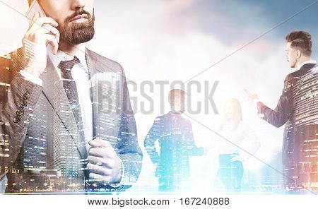 Group of business people is talking to each other. Man is looking at his phone screen while his colleague is on the phone. Toned image. Double exposure