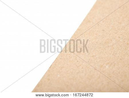 Fragment of a cardboard paper isolated over the white background as a copyspace shallow depth of field copyspace backdrop composition