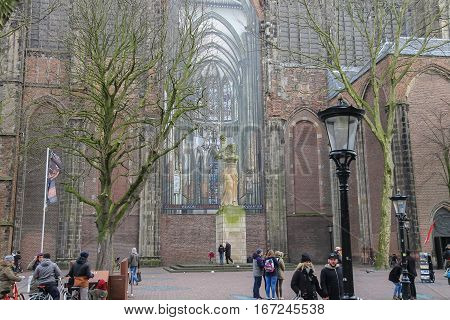 Utrecht the Netherlands - February 13 2016: People walking near St. Martins Cathedral in the historic city centre