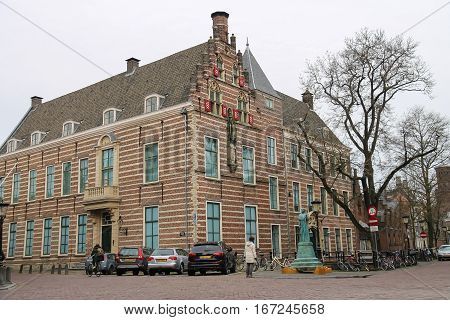 Utrecht the Netherlands - February 13 2016: Old building with statue in historic city centre