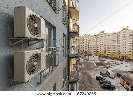 Air condiioners on fasade of reidenial apartmen building.