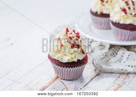 Red velvet cupcakes with buttercream frosting, copy space