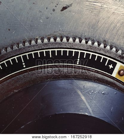 Old metal flywheel with scale. Maro photo
