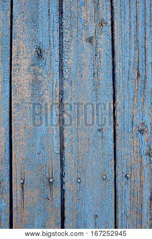 Old lath fence with peeled paint. Macro photo