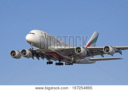 AMSTERDAM, THE NETHERLANDS - SEPTEMBER 12, 2016:Airbus A380 emirates unfolded with its landing gear before landing on the runway of Schiphol