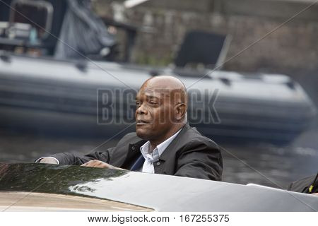 AMSTERDAM, THE NETHERLANDS ,JULY 10 2016;closeup photo of the  Famous american actor Samuel L Jackson in a l speedboat while shooting his latest film