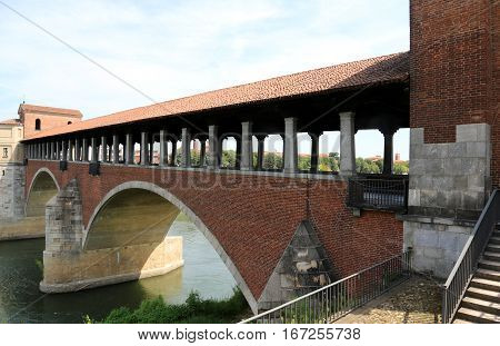 Old Bridge Over The Ticino River In Pavia City In Italy