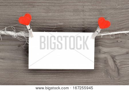 Hanging Valentines day card with red hearts