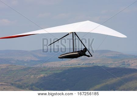 Hang glider flying in the Brecon Beacons, Wales