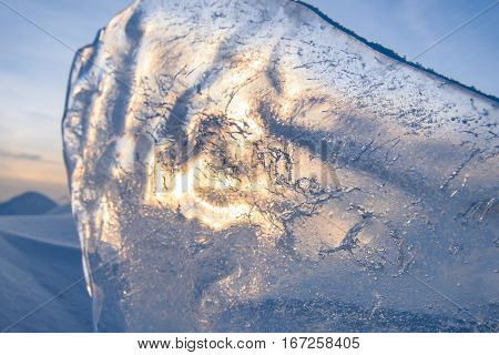 Blocks of ice gleaming in the sun, snow, frost, frozen water surface.
