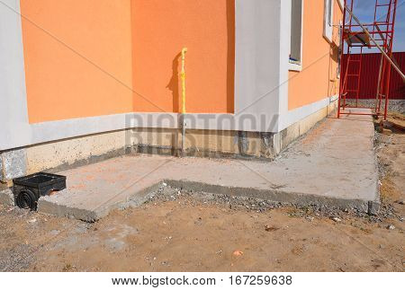 Close up on foundation wall waterproofing drainage gas pipe colorful facade . Properly insulated basement wall can save you money on heating and provide a dry comfortable living space.