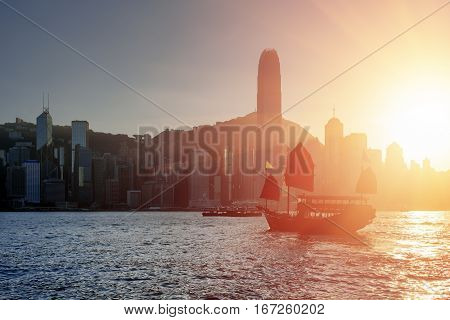 Traditional Chinese Sailing Ship With Red Sails At Sunset