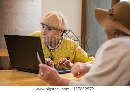 Senior ladies with laptop. Two old women indoor. Test the new software.
