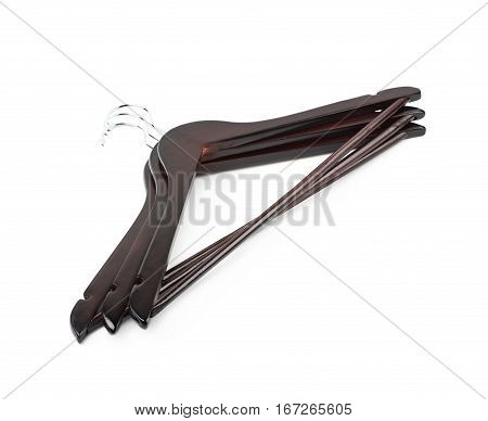 Pile of dark wooden hangers isolated over the white background
