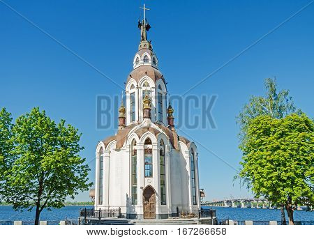 Orthodox temple on the waterfront against the blue sky in the middle spring