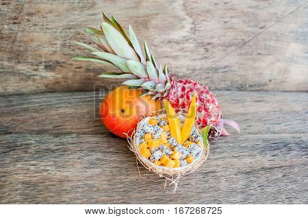 Fruit Salad With Dragon Fruit And Papaya In Half A Coconut