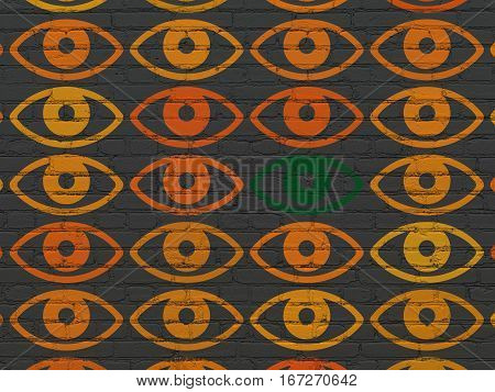 Protection concept: rows of Painted orange eye icons around green eye icon on Black Brick wall background