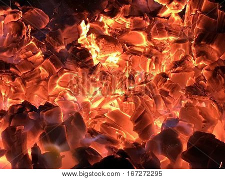 Several red hot coals make fire background