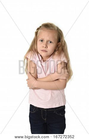 young little child girl having cold gesturing and trembling isolated on white background