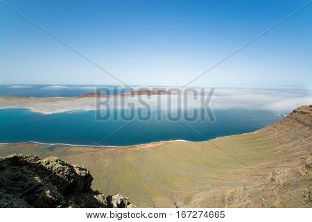 View on the volcanic coastline and Isla Graciosa from Mirador del Rio vista Lanzarote Spain