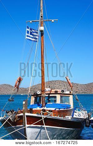 ELOUNDA, CRETE - SEPTEMBER 17, 2016 - Greek fishing boat moored in the harbour Elounda Crete Greece Europe, September 17, 2016.