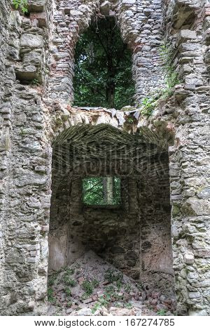 Ruins of the medieval church  - detail of gate and window