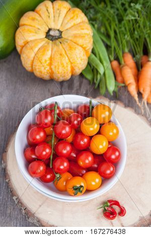 Autumn vegetables: tomatoes carrots pumpkin runner beans chilies