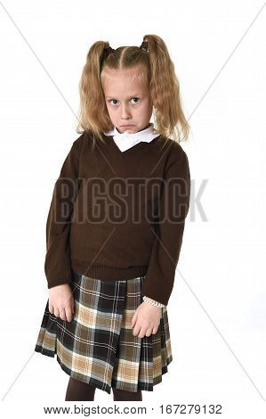 young sweet little schoolgirl girl with beautiful blonde hair in school uniform looking shy and timid as if scared or overwhelmed isolated on white background