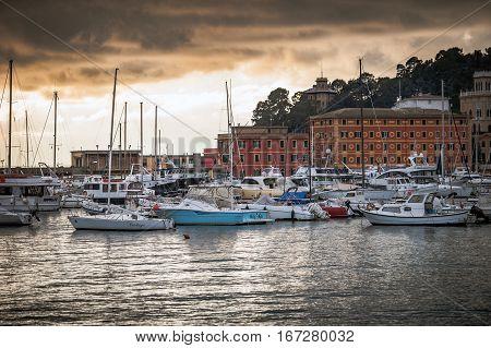 SANTA MARGHERITA LIGURE - DECEMBER 2016: Sunset over harbour with sailing yachts in Santa Margherita Ligure town, Italy