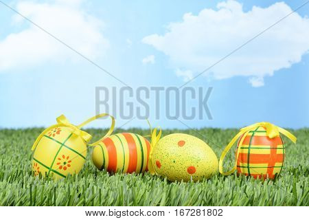 closeup of easter eggs with bows in grass