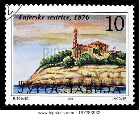YUGOSLAVIA - CIRCA 1991 : Cancelled postage stamp printed by Yugoslavia, that shows  Lighthouse Tajer sisters.