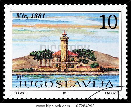 YUGOSLAVIA - CIRCA 1991 : Cancelled postage stamp printed by Yugoslavia, that shows  Lighthouse Vir.