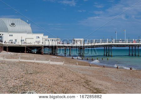 WORTHING ENGLAND - JULY 18. People on Worthing pier West Sussex England on July 18 2015