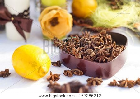 beautiful still life with lemons and spices in a box - star anise, anise, pepper