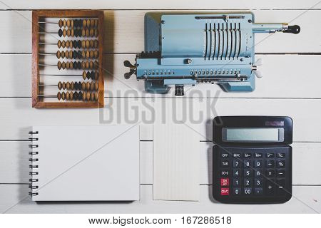 Old Calculating Machine On A Wooden Table